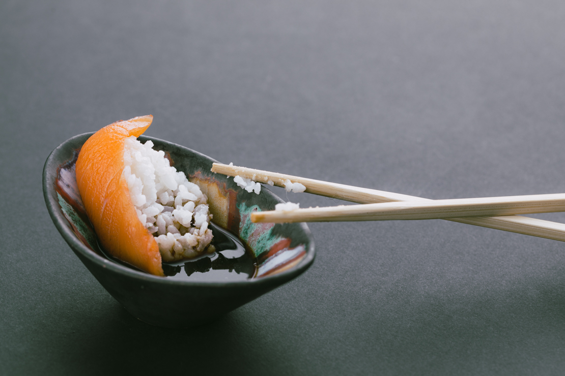 Sushi dropped in sauce bowl